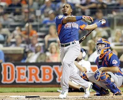 Kathy Willens/The Associated Press<br> American League's Yoenis Cespedes of the Oakland Athletics watches one of his hits during the first round of the MLB All-Star baseball Home Run Derby on Monday in New York.