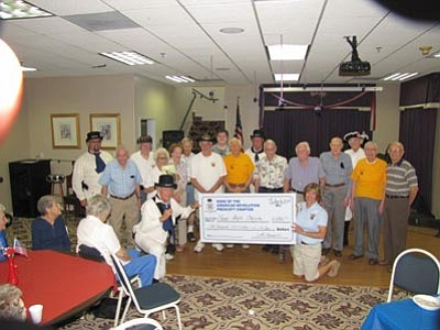 Courtesy photo<br>SAR Prescott Chapter President Steve Monez presents an oversized check to Honor Flight VP Nancy Page, surrounded by WWII veterans.