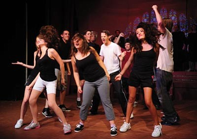Les Stukenberg/The Daily Courier<br>The cast sing and dance their way through a dress rehearsal Monday night for the Prescott Center of the Arts Teen Summer Stock Ensemble of Footloose the musical.