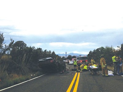 Joanna Dodder/The Daily Courier <br>A Prescott Valley woman died from injuries that she sustained in this single-vehicle rollover accident the evening of July 17, 2013 on Highway 89A east of the Yavapai County Fairgrounds.