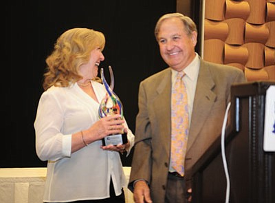 Les Stukenberg/The Daily Courier<br> Laura and Ron James and the James Family Trust were honored as the Philanthropist of the Year during the Yavapai County Community Foundation's 20th annual Joy of Giving luncheon Friday.