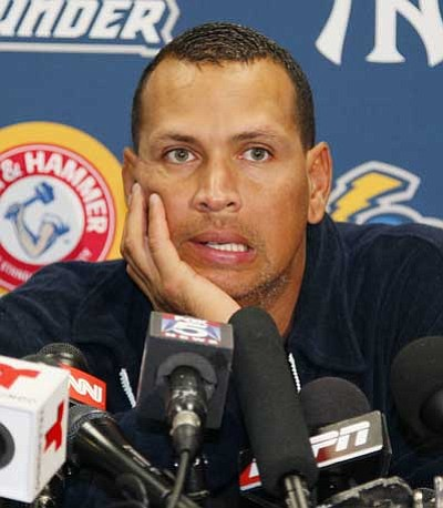 Tom Mihalek, file/The Associated Press<br> New York Yankees' Alex Rodriguez answers questions from reporters Friday during a news conference following a Class AA baseball game.
