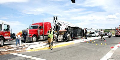 Sue Tone/Prescott Valley Tribune/Courtesy photo<br> Firefighters work to clear up a five-vehicle injury accident at Fain Road and Highway 69 on July 31.