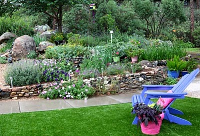 Courtesy photo<br> Master Gardener Virginia Mullins brought this Prescott garden to life with quirky sculptures, watering holes for birds and a broad assortment of colorful plants.