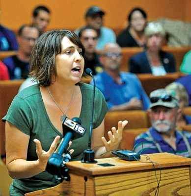 Matt Hinshaw/The Daily Courier<br>Amanda Marsh, widow of Granite Mountain Hotshot Eric Marsh, asks the Prescott City Council for two minutes of their time to ask them why they allowed her husband's benefits to be released for publication, Tuesday evening after a City Council workshop.
