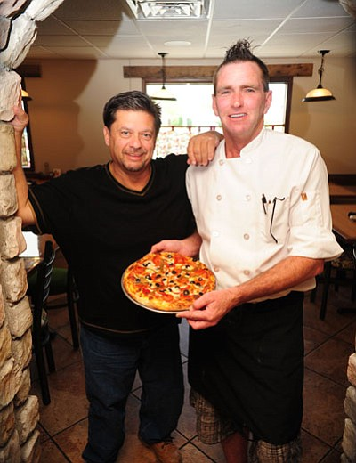Les Stukenberg/The Daily Courier<br> Tuscan Kitchen Owner Johvonn Zito and Chef-manager Doug Mattheis show off a pizza. Below, the dining room of the former Giovanni's holds 78 people for lunch and dinner.