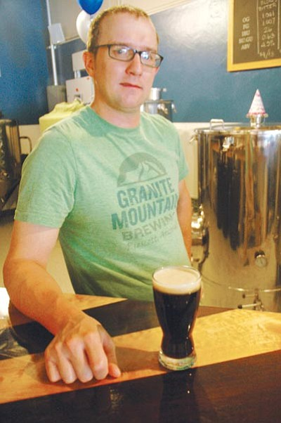 "Patrick Whitehurst/The Daily Courier<br> Michael Stanger of Granite Mountain Brewing helped create ""Pulaski Porter"" to raise funds for Yarnell Hill fire victims."