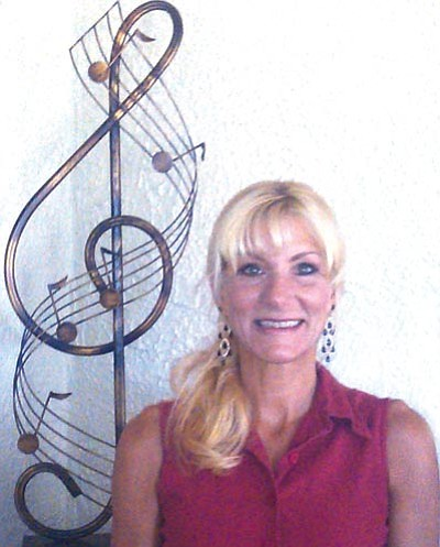 "Courtesy photo<br> Yarnell resident Denise Roggio was forced to evacuate during the Yarnell Hill fire on the same day that the Granite Mountain Hotshots died battling the flames. To pay tribute to them and raise money to help Yarnell rebuild, she has written a song, ""Blazing Honor."""