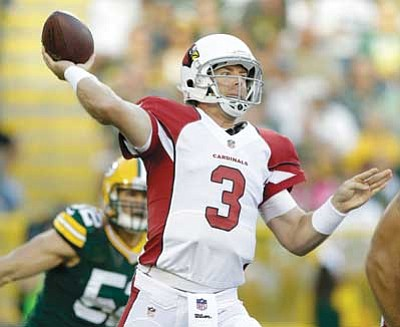Tom Lynn/The Associated Press<br> Arizona Cardinals quarterback Carson Palmer throws during the preseason NFL football game against the Green Bay Packers on Friday.