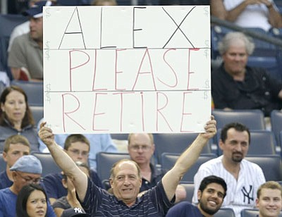 Kathy Willens/The Associated Press<br>A fan in the stands makes his feelings clear Tuesday night in the Bronx.