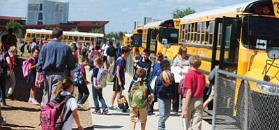Les Stukenberg/The Daily Courier<br>Students load up on the buses at Liberty Traditional School Tuesday afternoon in Prescott Valley.