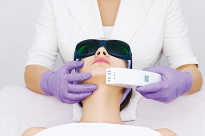 Photos.com<br>A patient receives laser hair removal.