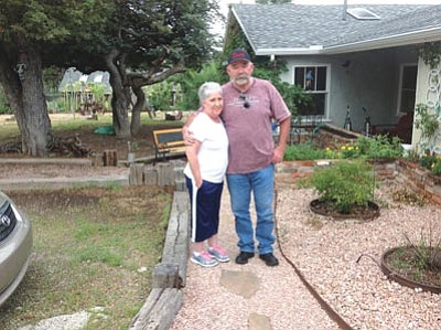 Ken Hedler/The Daily Courier<br>Margaret Duke goes for a walk with her husband outside their west Prescott home. Margaret is recovering from open-heart surgery and a double lung transplant.