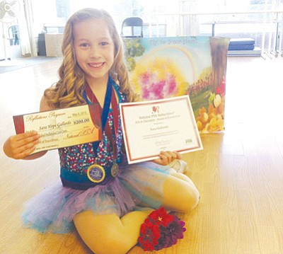 """Patrick Whitehurst/The Daily Courier<br> Nine-year-old dancer Sara Gallardo displays her winnings at Summer's DanceWorks in Prescott. Gallardo recently took second place in the National PTA Reflections program for her dance choreography. Gallardo entered the competition and danced to a Selena Gomez song from the Disney movie """"Tinker Bell."""""""