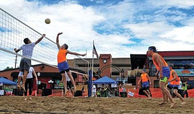 Matt Hinshaw/The Daily Courier<br> The One Hit Wonders face off against the Aztecs Saturday afternoon during the 4th annual Labor Day Luau at the Firehouse Plaza in downtown Prescott.