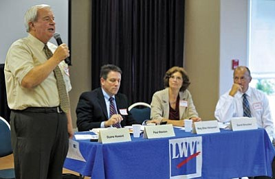 Matt Hinshaw/The Daily Courier<br> Chino Valley Unified School District Superintendent Duane Howard discusses budget cuts at a League of Women Voters forum Saturday while fellow superintendents David Smucker, Mary Ellen Halvorson and  Paul Stanton listen.