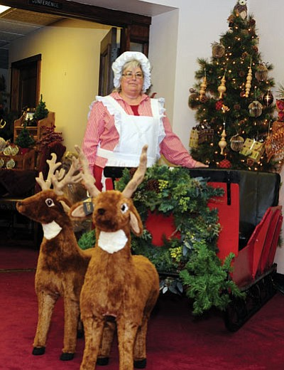Les Stukenberg/The Daily Courier<br>  Connie LeFebvre, owner of LeFebvre's at 101 East Gurley St., has transformed the store's basement into a Christmas decorating wonderland that is open  Friday-to-Sunday through Christmas.
