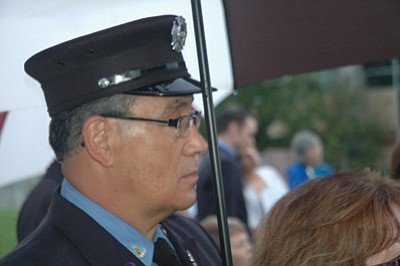 Ken Hedler/The Daily Courier<br> Joe Tufano, a retired New York City rescue firefighter, watches the 9/11 Healing Field Ceremony Wednesday evening on the Civic Center grounds in Prescott Valley.