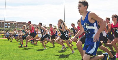 Les Stukenberg/The Daily Courier<br>Number 2 and 3 runners start the Ray Wherley Invitational at Embry-Riddle back on Sept. 8, 2012. After more than 40 years, this year's running on Saturday figures to attract the biggest field ever.