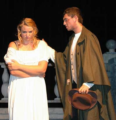 "Cheryl Hartz, Prescott Valley Tribune/Courtesy photo<br> Jean Valjean (Steve Gustke) tries to comfort Fantine (Bethany Clesceri) during a dress rehearsal for the Lonesome Valley Playhouse production of ""Les Miserables – School Edition."""
