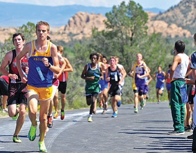 Matt Hinshaw/The Daily Courier<br>Prescott's Simon Paige leads a pack of runners up a hill Saturday afternoon during the 41st Ray Wherley Invitational cross country meet at Embry-Riddle in Prescott. Paige placed third overall out of 228 runners.