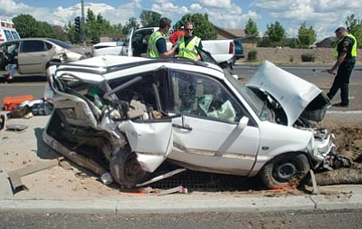 Prescott Valley Police Department/Courtesy photo<br> Investigators work the scene of a 6-vehicle crash Saturday on Glassford Hill Road in Prescott Valley.