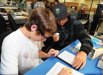 Les Stukenberg/The Daily Courier<br>Don Stagg from Bradshaw Mountain and Corey Cain from Ash Fork work on a lab project in a digital circuits class that is part of Yavapai College's JTED Mountain Institute Applied Pre-Engineering program.