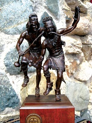 """Courtesy photo<br>""""The Dancers,"""" a sculpture featuring Barry Goldwater and Gail Gardner, will be up for bid at the auction."""