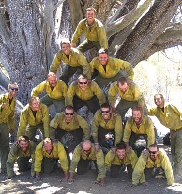Courtesy photo<br> The Granite MOuntain Hotshots form a pyramid in front of an ancient alligator juniper tree during the June 2013 Doce fire.