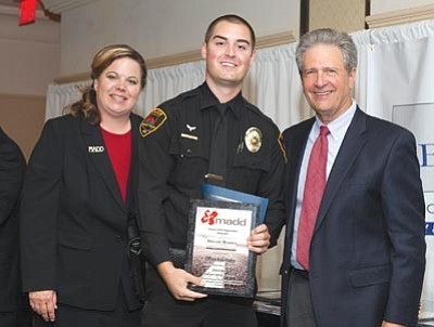 """Brad Armstrong/Courtesy photo<br>MADD officials award Prescott Valley PD Officer Kyle Hader during the organization's """"class and commitment"""" dinner on Sept. 13."""