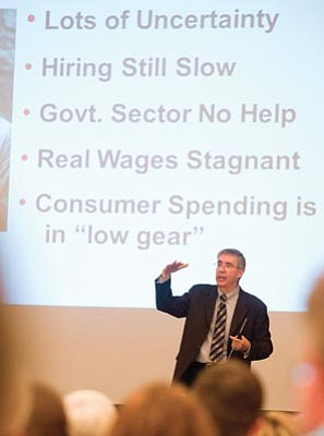 "Les Stukenberg/The Daily Courier<br>Lee McPheters, a research professor of economics at the W.P. Carey School of Business at ASU, returned to Prescott Tuesday to give his annual talk ""On the Road to Recovery."""