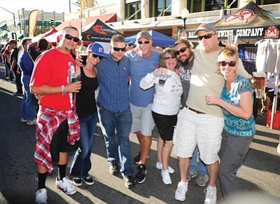 Les Stukenberg/The Daily Courier<br> A group of friends (who are not really in a witness protection program) are having a great time during the Oktoberfest celebration in downtown Prescott Saturday afternoon. The event benefited the Zeitz Sister Cities student exchange program.