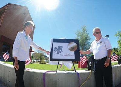 Les Stukenberg/The Daily Courier<br>  Prescott College President Kristin Woolever and City of Prescott Fire Department Chief Dan Fraijo unveil a placque at the dedication of an alligator juniper tree Monday in memory of the 19 fallen Granite Mountain Hotshots. Inset, Woolever gives opening remarks at the gathering.