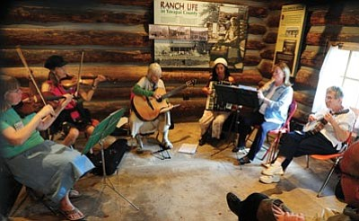 Les Stukenberg/The Daily Courier<br>A group jams at the Sharlot Hall Folk Music Festival Oct. 6, 2012. This year's festival is Saturday and Sunday, and admission is $8 for adults and $6 for kids.