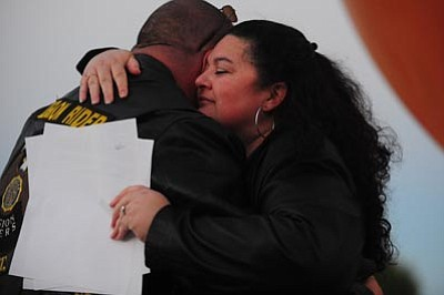 Les Stukenberg/The Daily Courier<br>Tina Roach and her fiancé share a hug after Roach spoke at the Take Back The Night event in Prescott Valley Wednesday. Roach is a domestic violence survivor and now has moved on to a healthy, loving relationship.