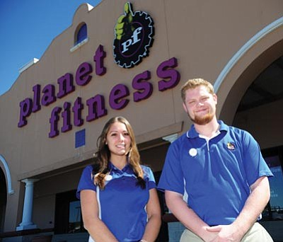 Les Stukenberg/The Daily Courier<br>Planet Fitness manager Brittany Micko and assistant manager Sean Pine pose outside the new club being built at Frontier Village.