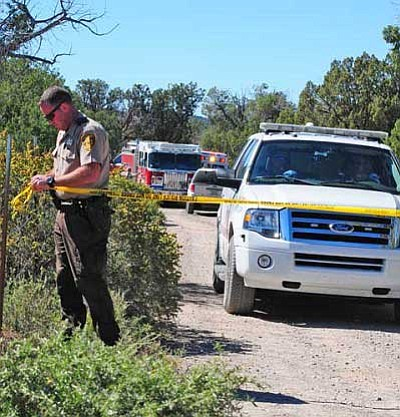 Kathi Sabot/Courtesy photo<br> A deputy cordons off access to the scene of a plane crash at Gunsite Ranch on Friday.
