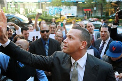 David Karp/The Associated Press<br>Alex Rodriguez arrives at the offices of Major League Baseball on Oct. 1 in New York. The grievance to overturn Rodriguez's 211-game suspension got under way before arbitrator Fredric Horowitz.