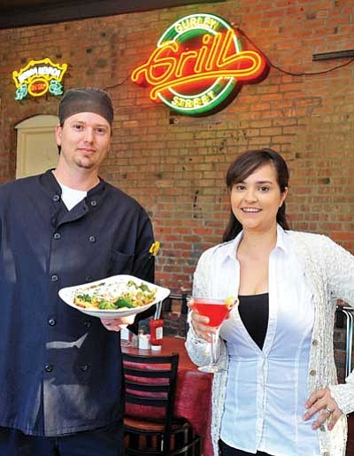 The Daily Courier<br> Chef Nathan Haverstock displays his signature Marco Polo Pasta while General Manager Natasha Roggow holds a Cosmopolitan Thursday afternoon in Prescott.