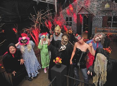 Matt Hinshaw/The Daily Courier<br>Vampires, ghouls and psycho clowns stand outside the entrance to the mansion inside the Scare Factor haunted house Wednesday night at the Frontier Village in Prescott. The haunted house opened to the public on Thursday night.