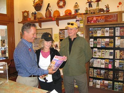 Courtesy photo<br>A couple from the San Francisco area speak with Chamber Visitor Center Manager Robert Coombs about revising their travel plans due to the shutdown of the Grand Canyon and the Prescott National Forest.