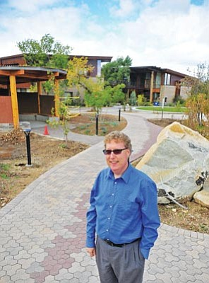 Matt Hinshaw/The Daily Courier<br>Dr. Brian Sajko, Prescott College Dean of Enrollment Management, is spearheading an effort that will lower tuition costs at the school by 11.8 percent beginning in fall 2014.
