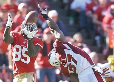 Ben Margot/The Associated Press<br> San Francisco 49ers tight end Vernon Davis catches a 35-yard touchdown over Arizona Cardinals strong safety Yeremiah Bell during the second quarter Sunday.