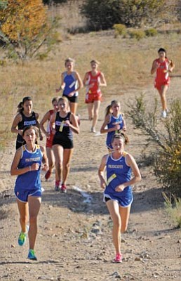 Matt Hinshaw/The Daily Courier<br>Prescott's Claren Fraher, right, and Jordan Twombly-Ellis lead a pack of runners Wednesday afternoon during the 9th Annual Yavapai County Cross Country Championships at ERAU in Prescott. Twombly-Ellis finished fourth and Fraher fifth individually.