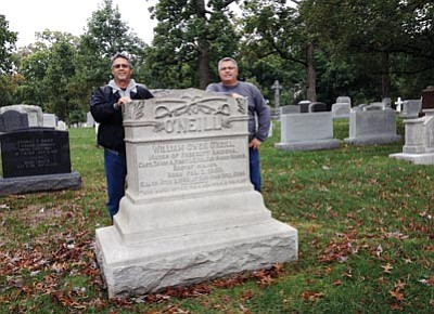 Courtesy Michelle Rawls<br>Charlie Mitchell, left, poses with his brother Danny at the grave of Prescott's favorite son, Buckey O'Neill, at Arlington National Cemetery.
