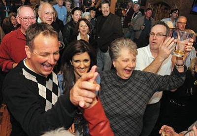 Matt Hinshaw/The Daily Courier<br> Greg Lazzell receives a high-five from a supporter Tuesday night after the results of the general election were announced at the Prescott Cantina.