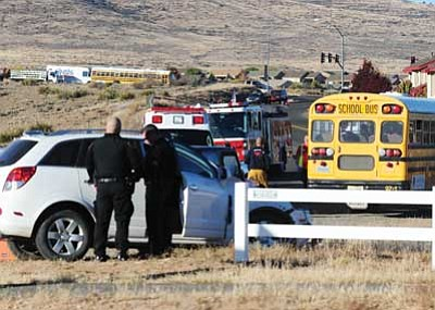 Les Stukenberg/The Daily Courier<br> Prescott Valley Police, Central Yavapai Fire and Lifeline Ambulance personnel work the scene of of two-vehicle collision at the intersection of Lone Cactus and Spouse Drive involving a Humboldt Unified School District bus and a small SUV Thursday morning.