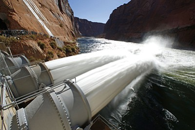 AP photo<br> This Nov. 19, 2012 photo shows a release of water into the Colorado River from bypass tubes at Glen Canyon Dam in Page, Ariz. An abundance of sand in the river is giving federal officials an opportunity to flood the waterway to spread the sediment throughout the Grand Canyon.