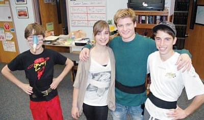 "Patrick Whitehurst/The Daily Courier<br>Pictured from left to right, and mostly out of make-up, are ""Shrek The Musical"" stars Wesley Bradstreet, Rebeca Adam, Austin Olsen and Ronnie Petkovich. The production opens  7 p.m. today at Prescott High School's Ruth Street Theater, 1050 North Ruth Street."
