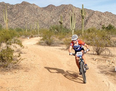 Courtesy photo<br>Chino Valley's Zoe Dunn rides the course at White Tank Regional Park during the season finale of the Arizona High School Cycling League's 2013 season.